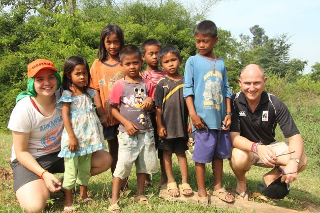 Manurewa High School Deputy Principal Phil Muir with some local children from Cambodia