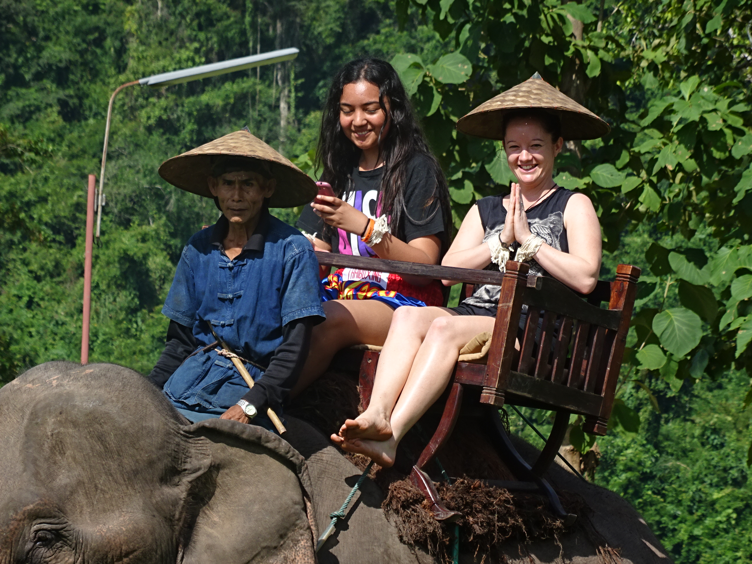 ITC's Short Course Team Leader Mel riding an elephant in Southeast Asia