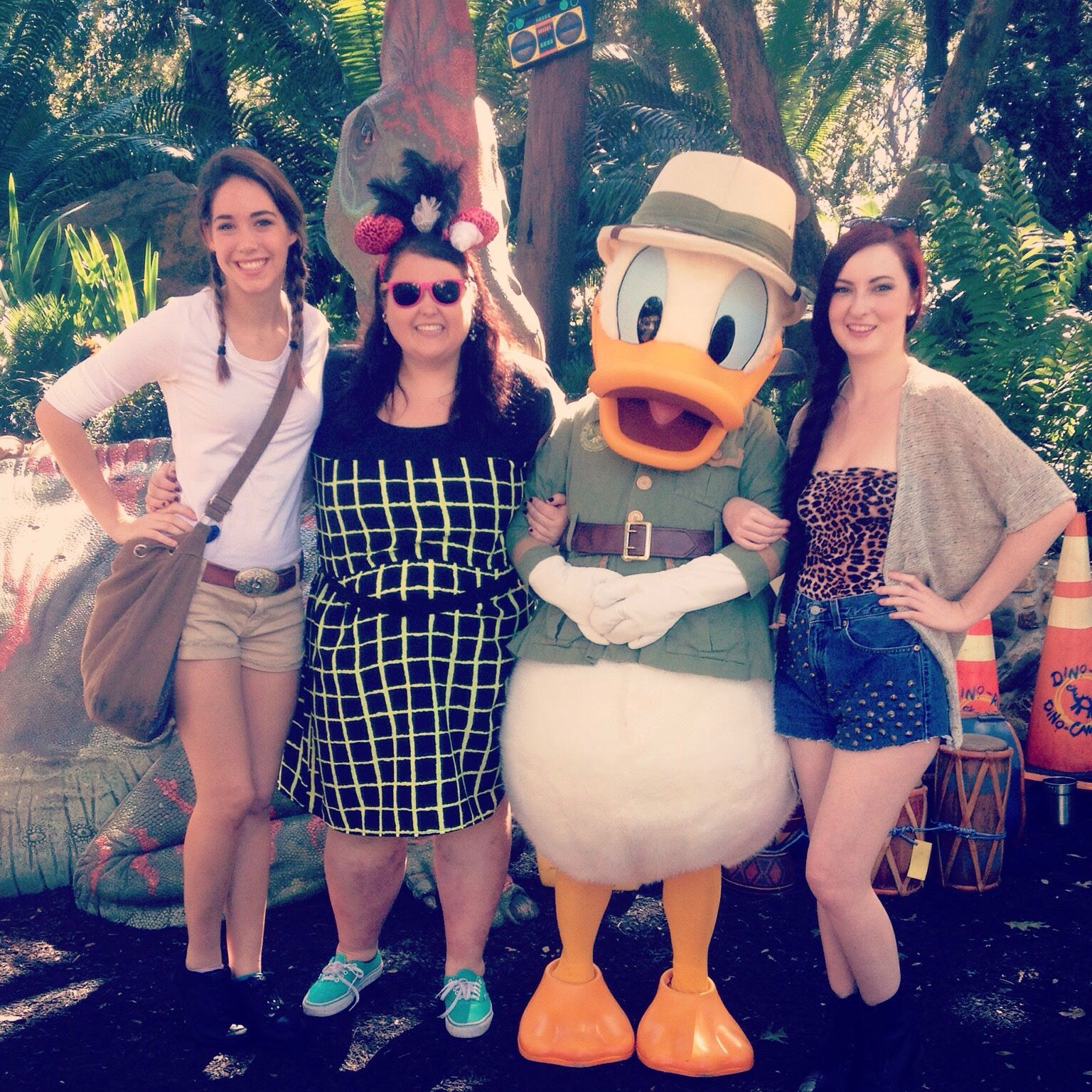 Jordana Grace (in the green and black dress) with friends and Donald Duck at Disney World, Orlando