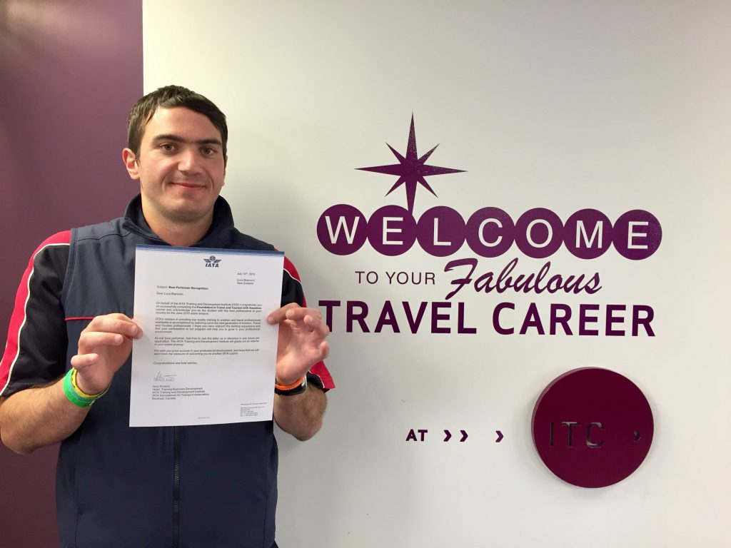 Luca Bianconi, an international student from Italy, holds the letter informing him of his outstanding IATA results.